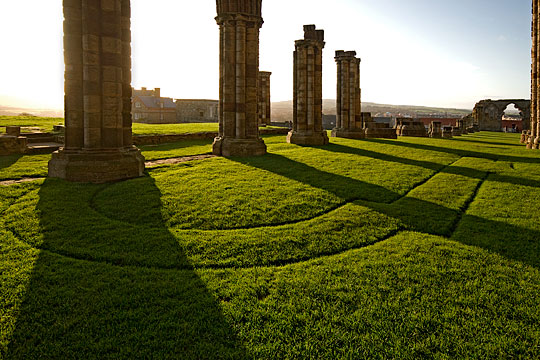View from the choir across the plan of Whitby Abbey, a 12th-century church, marked out in the lawn