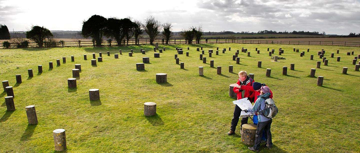 View of Woodhenge showing visitors at the site and the concrete posts that mark the positions of the wooden posts of the monument
