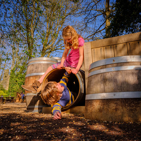 Two children play in Battle Abbey's play area