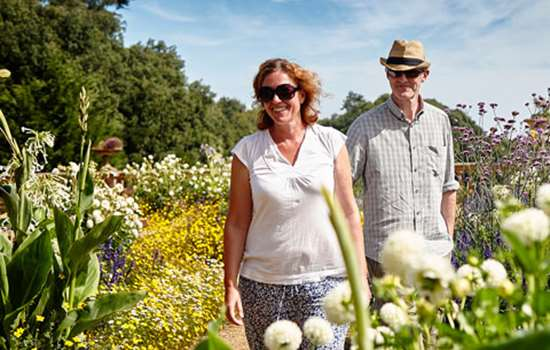 A couple enjoy the gardens of Osborne