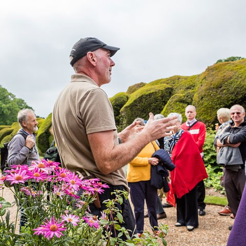 A gardener leads a tour at Walmer